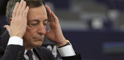 European Central Bank President Mario Draghi adjusts his earphones as he attends a debate on the ECB Annual Report for 2014,  at the European Parliament in Strasbourg, France, February 1, 2016. REUTERS/Vincent Kessler